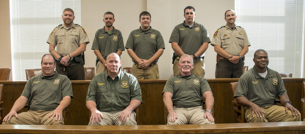 Reserve deputies sitting in court room