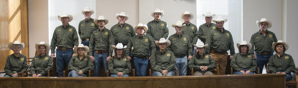 Sheriff's Posse members sitting in court room